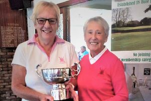 Jean Markham with Lady Captain Pam Clare presenting the trophy.