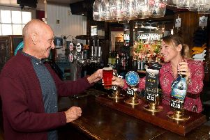 Manager Dawn Cawston serving a pint of Adhams Ghost Ship to regular customer John Creasey.