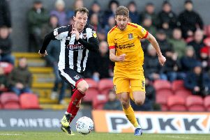 Martyn Woolford in action for Grimsby Town. EMN-190318-152023002