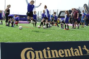 Schoolgirls being put through their paces at the Sussex FA Girls Football Festival