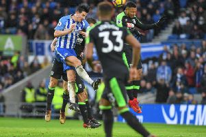 Lewis Dunk attacks a corner during the 2-2 draw with Bournemouth. Picture by Phil Westlake (PW Sporting Photography)