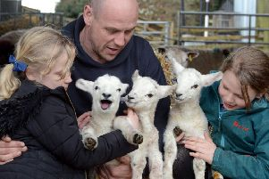 Shepherd Darren Sercombe with his children Imogen, eight and Robin, nine and triplet lambs born at Gaston Farm SUS-180327-220649008