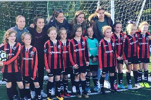 Lewes FC Women players Natasha Wells (Left Back) and Amy Taylor (Centre Back) supporting the Under 10s at their match on Sunday. Tash and Amy are in the back row.