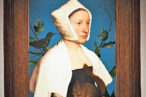 Hans Holbein the Younger's A Lady with a Squirrel and a Starling (Anne Lovell?)