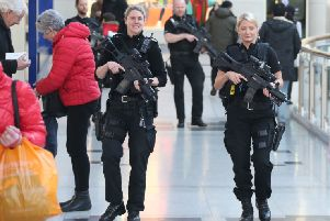 Armed police in Churchill Square, Brighton, today
