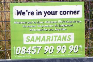 Samaritans sign on a fence  Image by Peter O\'Connor, licensed by Creative Commons from Flickr.