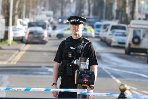 Police have closed off Elm Grove in Brighton following the serious assault
