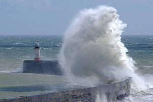 Huge waves at Newhaven. Photo by Jessie Cripps SUS-190313-105848008
