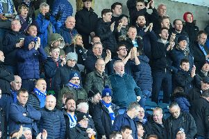 Brighton fans pictured at Millwall