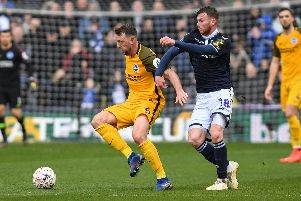 Dale Stephens in action at Millwall on Sunday. Picture by PW Sporting Photography