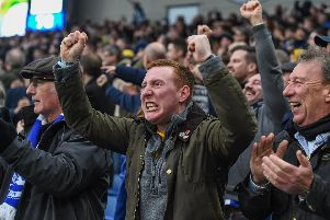 Brighton fans celebrate the win over Huddersfield this month. Picture by PW Sporting Photography