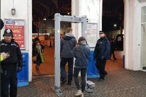 Police at Brighton railway station with the metal detector. Picture via Brighton and Hove Police