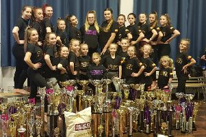 Justdance Academy celebrating with their trophies