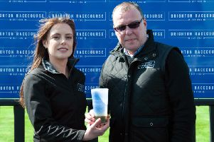 Brighton Racecourse's catering manager Kristy Cutler and executive director Paul Ellison with the new reusable plastic cup. Photograph: Roger Dean