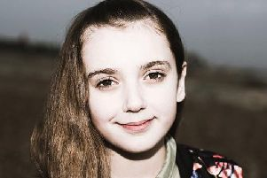 Delilah McNulty, 11, before the head shave challenge