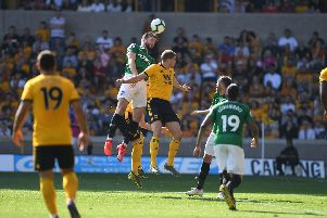 Shane Duffy attacks a cross during Brighton's Premier League match at Wolves. Picture by PW Sporting Photography