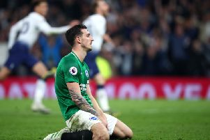 Lewis Dunk on his knees after Tottenham's late winner. Picture by Getty Images