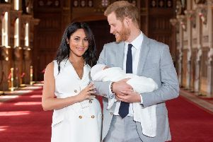 Prince Harry, Duke of Sussex, and his wife Meghan, Duchess of Sussex, with their newborn baby son Archie in St George's Hall at Windsor Castle (Photo: DOMINIC LIPINSKI/AFP/Getty Images)