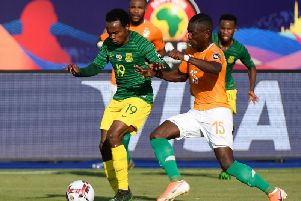 Brighton & Hove Albion forward Percy Tau (left) in action for South Africa against Ivory Coast. Picture courtesy of Getty Images