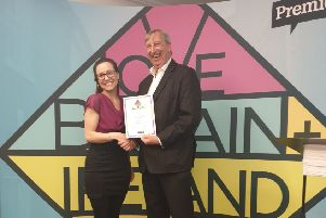 Rosie Downham, a supporter of Time to Talk Befriending, accepts the Love Britain + Ireland Award from Premier chief executive Peter Kerridge