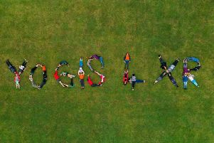 Brighton Yoga Foundation joins forces with Extinction Rebellion Brighton on the first day of Brighton Yoga Festival in a visual act of solidarity. Photograph: James Beer, 23 Digital