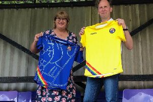 Sophie Cook andDavid Shrigley with the Rainbow Rovers shirt