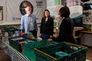 Jeremy Corbyn, shadow environment secretary Sue Hayman, foodbank volunteer Paul Redfern, and Whitehawk Foodbank communications manager Anne Amner