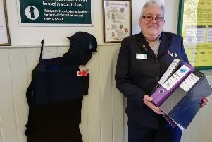 Laura Lee, who works at Arundel ticket office, with her research on Brighton railworkers during World War One