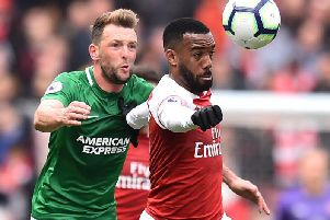 Brighton and Hove Albion midfielder Dale Stephens in action against Arsenal's Alexandre Lacazette last season