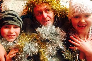 Brighton musician, Glen Richardson, with his children who also feature on the festive track