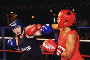 Aimee Edwards with an opponent during an Ultra White Collar Boxing match