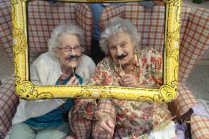 Barford Court residents Florence Edser (left) and Suzanne Golding (right) gamely don fake moustaches in support of Movember.
