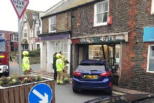 Emergency crews at the scene of the collision in Rottingdean. Picture: Annabel Tarrant