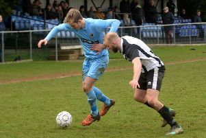 Ardley United's Matt Cruse is held off by a Lydney Town defender