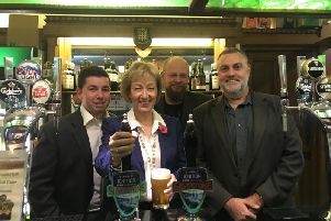 Andrea Leadsom pulls a pint of Ignition with Silverstone Real Ale Brewery
