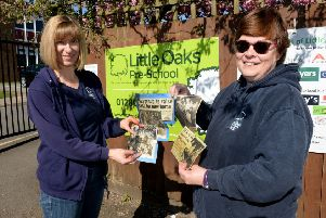 Little Oaks Pre-school 50th anniversary. Setting Manager, Nikki Lloyd, left and Pre-school Practitioner, Sue Corns, with some old press cuttings. NNL-180105-142310009