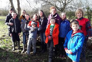 Poppy planting in Brackley for the Ribbon of Poppies project. 5th Brackley cubs. NNL-180805-093429001