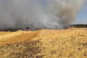 Firefighters tackling a fire on a farm in Ardley on August 6, at 1.40pm.