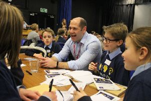 One of the business leaders enjoys talking to the pupils during the Q&A NNL-190802-161317001