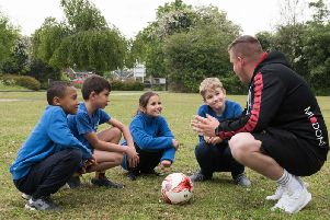 MK Dons coach Jamie Atkinson working with Buckingham Primary School pupils