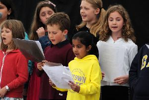 Members of Buckingham Children's Choir and Bittersweet Music performing at Music in the Market