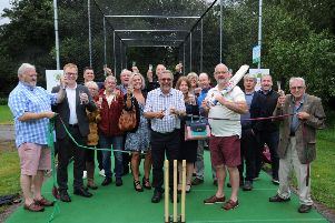 Thornborough Cricket Club's new nets are officially opened - pictured is Paul Chapman, president, cutting the ribbon in the presence of Ian Davies, TCC chairman (with bat) and sponsors and friends of the club