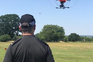 Library image of police officers flying a drone