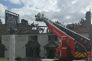 Firefighters tackle the fire at The Village Gate in Wendover