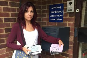 Anti-Brexit campaigner Sarah Jones delivers messages from Aylesbury residents to David Lidington's constituency office