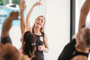 Owner Kirsty Lowe leads a Sweat Studios yoga class
