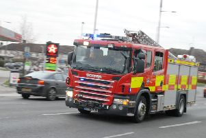 A Bucks Fire and Rescue service engine travelling in Aylesbury
