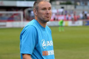 Kevin Wilkin saw Brackley Town's nine-match unbeaten run come to and end at Boston United