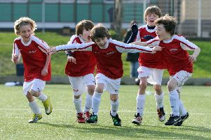 Youngsters enjoying a recent Arsenal Soccer School