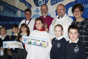 Pupils at Winslow C of E pose with Buckingham Bishop Dr Alan Wilson